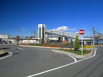 Takekawa Station - View of the area on the south side of the station, showing the pedestrian overbridge to the opposite side of the tracks, November 2012