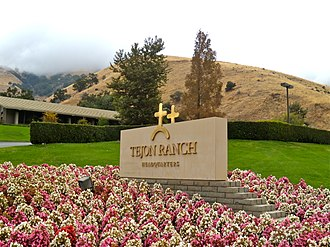 Tejon Ranch - Tejon Ranch Company headquarters, with some of the ranch disappearing into the cloud behind. This will be the site of Tejon Mountain Village. Note trademarked cattle brand.