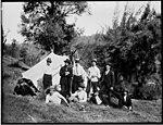 Ten men near a white tent (3054173415).jpg