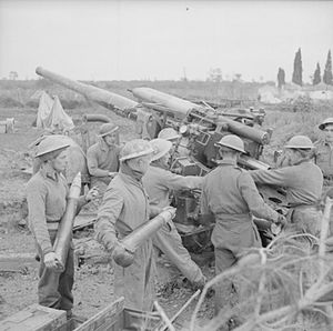 1st Norfolk Artillery Volunteers - 3.7-inch AA gun in action in Italy.