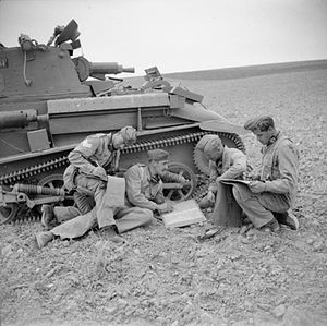 14th/20th King's Hussars - Light Tank Mk VI and crew from 14th/20th Kings Hussars in Iraq, 25 April 1942.