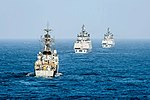 The Indian Navy Kora-class corvette INS Kirch (P62) and Shivalik-class stealth multi-role frigates INS Sahyadri (F49) and INS Satpura (F48) transit while conducting a live-fire surface gun exercise during Malabar 2016.jpg