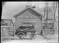 The Petone Fire-Brigade Station with hand engine in front, in 1892 ATLIB 273151.png