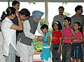 The children tying 'Rakhi' to the Prime Minister, Dr. Manmohan Singh, on the occasion of 'Raksha Bandhan', in New Delhi on August 09, 2006.jpg