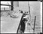 Three men on the deck of a sailing vessel, 1890-1953 (7688334694).jpg