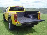 Truck bed liner using permanent ArmorThane polyurethane spray-on protective coating