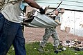 U.S. Air Force Senior Airman Joel Chamberlain, foreground, and Master Sgt. Kenneth Green, both with the 552nd Maintenance Squadron at Tinker Air Force Base, Okla., help clean up a home in Moore, Okla., May 24 130524-F-IE715-154.jpg