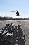 U.S. Army 1st Sgt. Jerramy Wood, right, with Headquarters and Headquarters Company, 2nd Battalion, 2nd Combat Aviation Brigade; Spc. Anthony Bell, middle, and Spc. Johnny Burgos, motor transport operators 131122-A-WG463-111.jpg