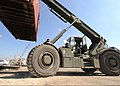 U.S. Army Pfc. Jonathan Johnson, a cargo specialist, is part of a team working the Joint Logistics Over-the-Shore (JLOTS) system to get cargo ashore in Port-au-Prince, Haiti 100208-N-HX866-008.jpg