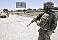 U.S. Army Spc. Christopher W. Lord, right, assigned to the 2nd Battalion, 23rd Infantry Regiment, mans a traffic control point in the Panjwai district, Kandahar province, Afghanistan, May 23, 2013 130523-A-MX357-208.jpg