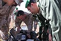 U.S. Marine Corps 1st Lt. Ben Baker, an assistant intelligence officer for the 24th Marine Expeditionary Unit, observes the live-video feed from an RQ-11B Raven unmanned aerial system with members of the Royal 120412-M-FR139-055.jpg