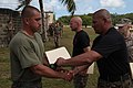 U.S. Marine Corps Master Sgt. Jose A. Ruiz, right foreground, presents a certificate to a graduate of the Marine Corps Martial Arts Program instructor course at U.S. Naval Computer and Telecommunications Station 130405-M-LN208-024.jpg