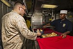 U.S. Marines and Sailors with the 26th MEU and USS Kearsarge share a Christmas meal 151222-M-PA636-087.jpg