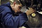U.S. Navy Aviation Machinist's Mate Airman Apprentice Saxton Dees works on an aircraft engine in the jet shop aboard the aircraft carrier USS Nimitz (CVN 68) July 30, 2013, in the Gulf of Oman 130730-N-IB033-084.jpg
