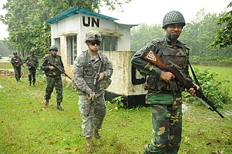 File (formation) - Troops from the U.S. and Bangladesh March in single file during a tactical training exercise during 2014.