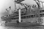 USS Proteus (AS-19) loads Polaris missile onto USS Patrick Henry (SSBM-599) in March 1961.jpg