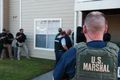 US Marshals entering building.png
