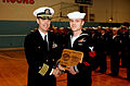 US Navy 030206-N-0967W-047 Capt. Bill Goodwin, Commanding Officer Pre-commissioning Unit Ronald Reagan (CVN 76), presents a plaque to Ronald Reagan's Sailor of the Year for 2002, Operations Specialist 1st Class Brian Hollars.jpg