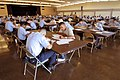 US Navy 030313-N-3228G-001 Nearly 250 candidates for E-5 mark their answer sheets while taking the March 2003 advancement exam at the Club Pearl Complex.jpg