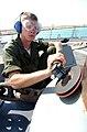 US Navy 030426-N-6141B-009 Seaman Nicholas Dalton from Corpus Christi, Texas, polishes one of the ship's capstans.jpg