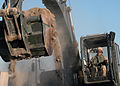 US Navy 040405-N-1261P-047 Equipment Operator 2nd Class Jeffery Atchison assigned to Naval Mobile Construction Battalion Seventy Four (NMCB-74) operates an excavator to complete barriers.jpg