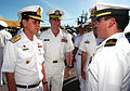 US Navy 040630-N-4104L-010 Commander-in-Chief of the Royal Thai Fleet, Adm. Vichai Yuwanangoon speaks with COMDESRON One's Operations Officer Lt. Miguel Iniguez, during an inspection of troops that concluded the opening ceremon.jpg