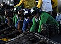 US Navy 041025-N-5384B-008 Flight deck personnel work together to rig the emergency-landing barricade during a drill aboard the Nimitz-class aircraft carrier USS Abraham Lincoln (CVN 72).jpg