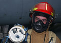 US Navy 041115-N-6125G-006 Fireman Brandon Dossey uses a Naval Firefighters Thermal Imaging (NFTI) system during a fire drill aboard the Nimitz-class aircraft carrier USS Harry S. Truman (CVN 75).jpg