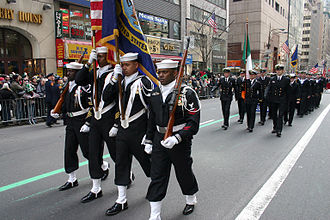 Fifth Avenue - Members of Naval Reserve Center Bronx's color guard march up Fifth Avenue at the 244th Annual NYC St. Patrick's Day parade