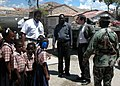 US Navy 050423-N-0000B-005 U.S. Congressman Kendrick Meek (FL-D), left, and the U.S. Ambassador to Haiti, Honorable James Foley, right, speak with the director of the Nativite School in Gonaives, Haiti.jpg
