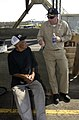 US Navy 050906-N-6436W-431 Commanding Officer, USS Tortuga (LSD 46), Cmdr. Mark H. Scovill, tries to convince a stranded New Orleans citizen to take refuge aboard his ship.jpg