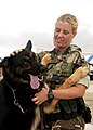 US Navy 050916-N-1082Z-005 A member of the Auxillary Security Force team gives some positive re-enforcement to her guard dog at he 2005 Naval Air Station Oceana Air Show.jpg