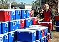 US Navy 051213-N-9274T-003 Molly Reagan, a volunteer with The American Red Cross, stacks coolers brought to New Orleans by The American Red Cross.jpg