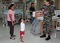 US Navy 060531-N-9076B-055 Air Force Senior Airman Danielle Fahlbush of Harrisburg, Pa., entertains a little girl in the recovery ward.jpg