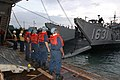 US Navy 061017-N-2970T-006 Boatswain's mates aboard USS Essex (LHD 2) line up to secure an incoming Landing Craft Utility (LCU) onto the stern gate of the ship.jpg