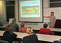 US Navy 070409-N-0857S-003 Emergency Management Officer, Lt. Cmdr. Neil Uemura, briefs personnel from Naval Support Activity New Orleans, about hurricane preparedness.jpg