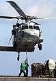 US Navy 070515-N-3038W-210 Sailors from USNS Bridge (T-AOE 10) attach supplies to an MH-60S Seahawk from the.jpg