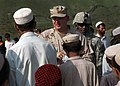 US Navy 070802-N-3385W-768 Commanding Officer Provincial Reconstruction Team Khost, U.S. Navy Cmdr. David Adams hands out candy to school children before the groundbreaking ceremony in Jaji Maidan for a new school building.jpg