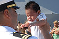 US Navy 070829-N-9909C-005 Lt. Charlie Limon, force protection officer aboard guided-missile destroyer USS Preble (DDG 88), meets his son for the first time after returning from a 7.5-month deployment as part of John C. Stennis.jpg