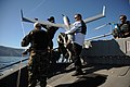 US Navy 080207-N-5366K-519 Civilian contractors recover a Scan Eagle unmanned aerial vehicle launched from a MK V naval special warfare boat off the coast of San Clemente Island.jpg