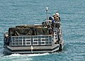 US Navy 080724-N-3392P-020 landing craft utility assigned to Assault Craft Unit (ACU) 2 prepares to offload cargo.jpg