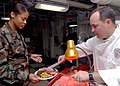 US Navy 081127-N-2456S-033 Cmdr. Aaron Stanley, supply officer aboard the aircraft carrier USS Theodore Roosevelt (CVN 71), serves roast beef to Master-at-Arms 2nd Class Stephanie Williams, from Washington, during a Thanksgivin.jpg