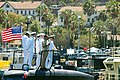 US Navy 090806-N-6031Q-004 Officers stand on the sail of the Los Angeles-class attack submarine USS Albuquerque (SSN 706) as she arrives at her new homeport at San Diego, Calif.jpg