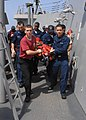 US Navy 100201-N-7088A-131 ailors, aboard the Arleigh Burke class guided-missile destroyer USS Farragut (DDG 99), participate in a casualty training evolution.jpg