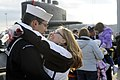 US Navy 100203-N-8467N-011 Machinist's Mate 2nd Class Trevor Fredrick hugs his girlfriend moments after the Los Angeles-class attack submarine USS Philadelphia (SSN 690) pulls into Submarine Base New London.jpg