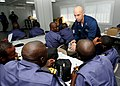 US Navy 100308-N-6676S-108 Sailors from the Nigerian navy listen as Damage Controlman 1st Class Cory Webb, from Smithfield, Va., demonstrates how to properly use an emergency escape breathing device (EEBD) during a training ses.jpg