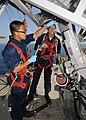 US Navy 100421-N-1082Z-022 Electronics Technician 3rd Class Tri D. Vu, from Las Vegas, works aloft while conducting maintenance on the AN-SPS-49 air search radar as Electronics Technician 1st Class James R. Edwards, from Virgin.jpg