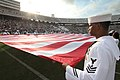 US Navy 100925-N-7656T-056 Dallas-area Navy recruiters and recruits enrolled in the Delayed Entry Program hold an American flag on the field of the.jpg