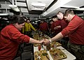 US Navy 101125-N-9626Y-083 Sailors give thanks before enjoying their Thanksgiving meal aboard the aircraft carrier USS George Washington (CVN 73).jpg