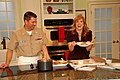 US Navy 110126-N-6778P-025 Culinary Specialist 1st Class John Talbott serves a meal to host Cyndi Edwards on the WFLA television Daytime Show durin.jpg
